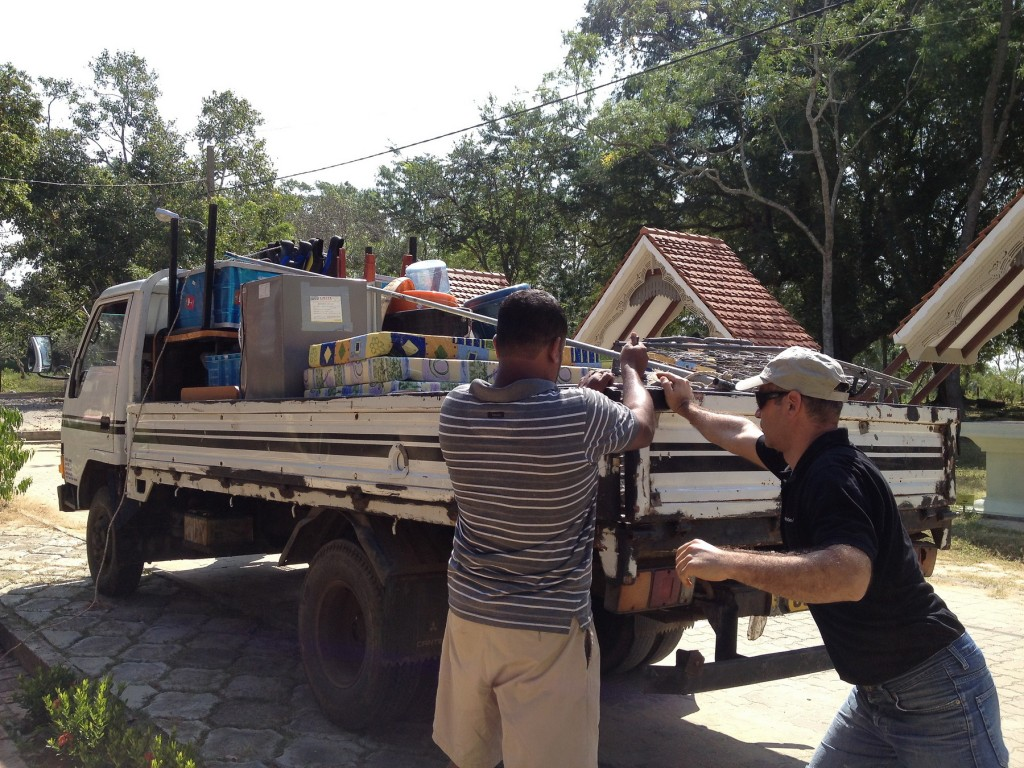 Zafer helps load the truck that transported our goods from a storage room at the museum in Kasagala back to the house in Ambalantota.