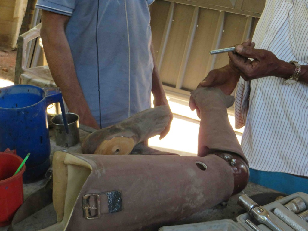 The welding crew adjusts a prosthesis.  Photo by K. Trethewey.