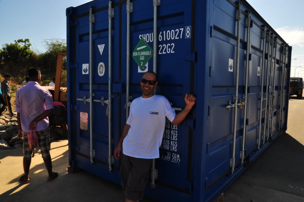 Zafer smiles, happy to see our container on the ground in Hambantota port. Photo by Staci Willis.