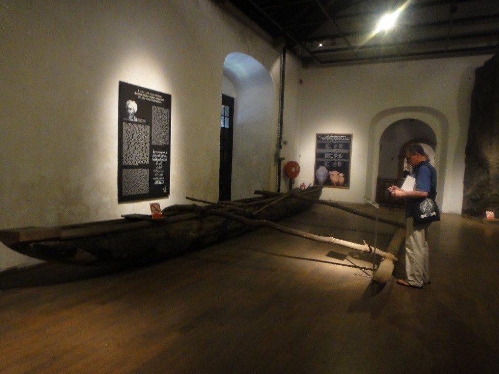 Andrew examines a traditional local fishing canoe, one of several remarkable antique vessels preserved at the museum. Photo by Karen Martindale.