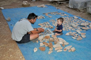 Justin gives Max his first lesson in sorting ceramics.