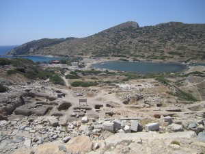 "The double harbor at ""New Knidos."" What factors made the city a more favorable locale?"