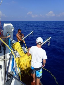 Leor shows his son how to tend the ROV's cable (photo: Douglas Inglis)