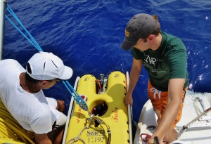 Leor and Doug pull the disabled ROV back aboard Sea King.