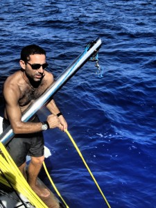 Leor hauls in the umbilical as fast as he can.
