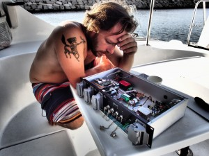 Ishay examines the malfunctioning SeaEye control station.