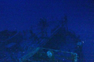 The ROV momentarily hangs in the current above the ship, before...