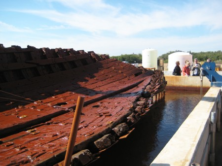 "Reconstructed hull of ""La Belle"" lifted from the conservation tank for inspection."