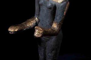 Bronze female figurine with head, lower arms, and feet clad in gold (KW 3680),(16.4 cm. in ht.).(Photo: INA) Slide# KW-10769. REF640