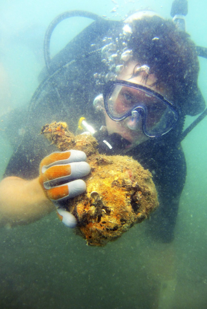 Figure 4. Chad Gulseth (author) with one of the recovered onion bottles.