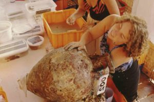 Conservators removing sediment from amphoras (Photo: INA) Slide # TEK-060. REF660