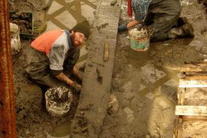 Michael Jones and Rebecca Ingram excavate the last in-situ plank of YK 11.  REF4815