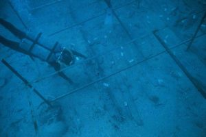 View of the exposed hull timbers in situ beneath the iron working grid. (Photo: INA) Slide# YA7-201 REF750