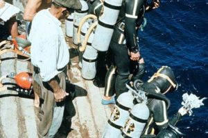 1961. Several divers preparing to enter the water from the barge. (Photo: INA) Slide# YA7-89. REF757