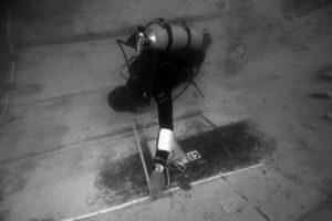 Rodrigo Torres recording preserved ceiling planks. REF4438