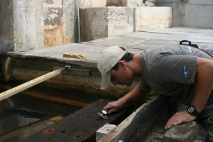 Measuring the fasteners located on the portside garboard plank (photograph, K. Bojakowski).  REF4501