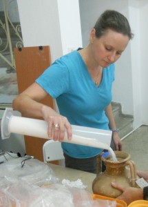 Kristine Trego measures a table amphora from Tektaş Burnu.