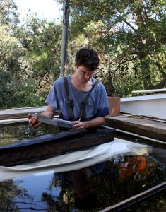 Michael Jones cataloging the main keel timber of YK 14 in the freshwater storage tanks at INA's Bodrum Research Center.