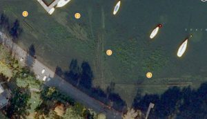 Fig. 3: A satellite image of Shelburne Shipyard showing the four steamer wrecks. From left to right: A. Williams, Phoenix II, Burlington and Whitehall. (Bing Maps, 2013).