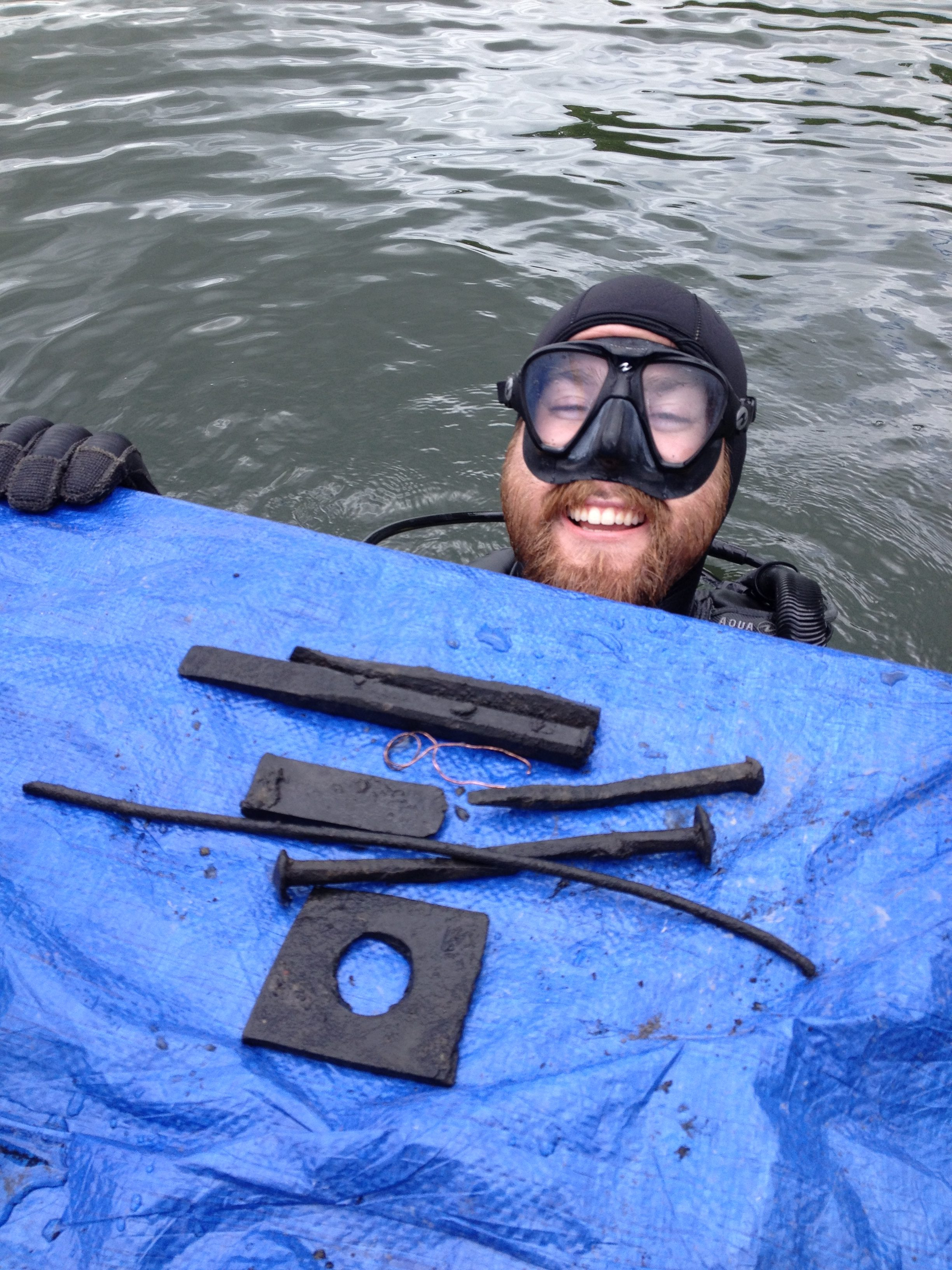 Dan Bishop bringing up the chisels and other artifacts recovered during the dive.