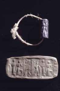 "Syrian cylinder seal with the long dead merchant's ""signature"" and its clay impression. (Photo: INA, Slide # CG624)."