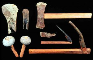 Scrap bronze tools with modern handles and two stone hammers (Photo: INA, Slide # CG590).
