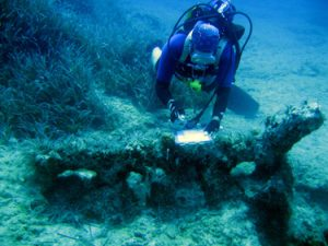 A diver records an iron anchor on the seabed near Cape Greco.