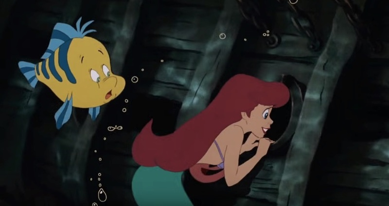 Ariel peers into an anachronistic porthole. (Image: The Little Mermaid).