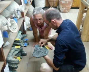 Hirschfeld and Lehner inspect an ingot fragment at INA's Research Center in Bodrum, Turkey.